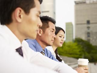 asian businesspeople looking depressed