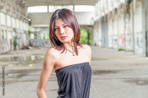 canvas print picture Chinese woman standing in abandoned building