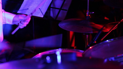 Drummer Playing in disco lights