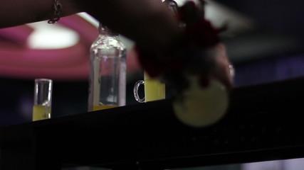 man preparing a shot cocktail