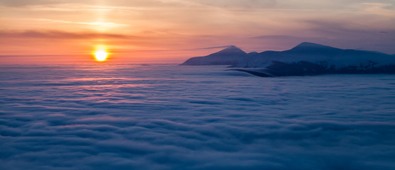 Mountain above the clouds