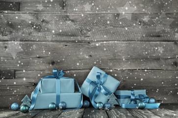Weihnachtsgeschenke als Holz Hintergrund für Gutschein