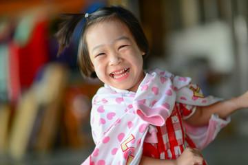 Cute Asian girl laughing.