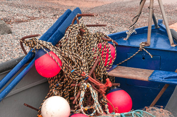 Traditional Fishing Boat with Nets and Bouys