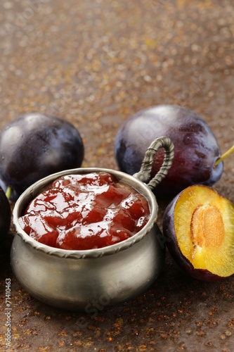 natural organic plum jam with fresh berries - 71410463