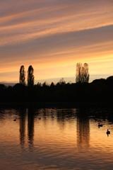 Sonnenuntergang am See im Englischen Garten
