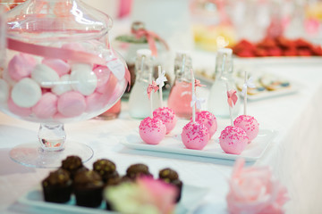 Pink cake pops on a dessert table