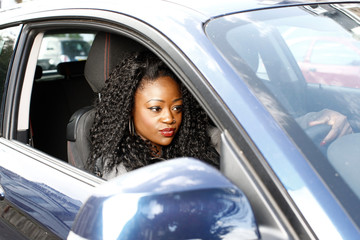 Young woman driving a car waiting in traffic