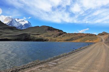 Gravel road along the shore of the lake