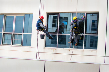 Men cleaning windows