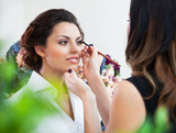 Fototapety Make-up artist doing make up for young beautiful bride