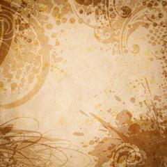 Old paper with floral grunge splatter.