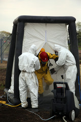 The person in chemical protection suit go out from danger zone