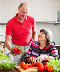 Senior man and mature woman  cooking  lunch