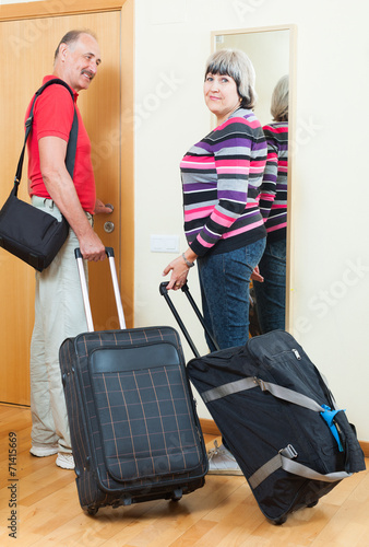 canvas print picture mature  man and woman leaving the home