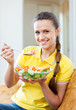 Happy  girl eating veggie salad