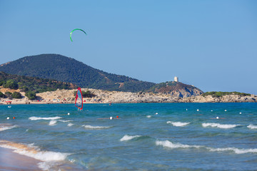 Beautiful beach with kitesurfer in Sardinia