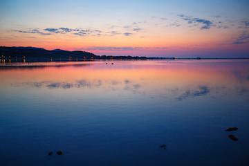 Beautiful sunset over water on Sardinia island