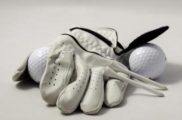 Gold glove, tees, golf balls