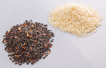 Black and white glutinous rice over white background