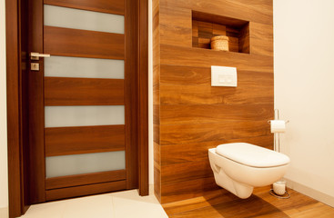 Toilet in wooden bathroom