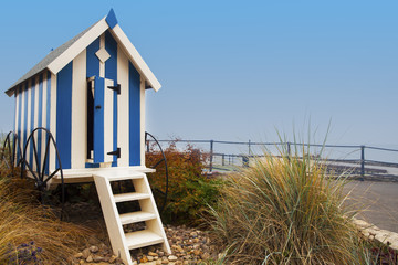 Striped blue beach hut on Filey promenade