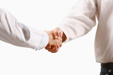 Closeup of a business handshake, isolated on white.
