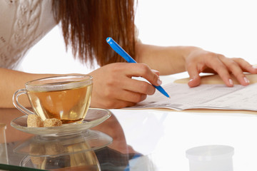 A young businesswoman having tea