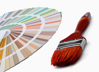 Close-up of a color palette and a brush ,isolated on white back