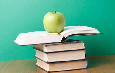 An apple on a pile of books