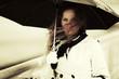 Sad beautiful fashion woman with umbrella in the wind