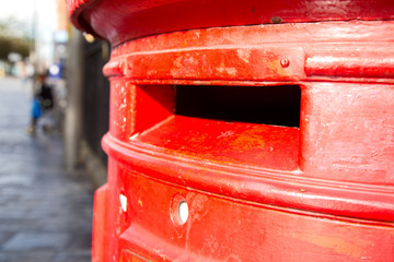 a close up of a traditional english letter box.