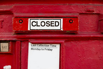 a closed british red letterbox.