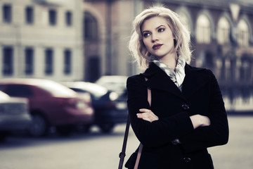 Young fashion woman on the city street
