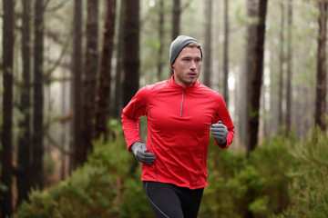 Running man in forest woods training