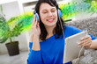 Young modern girl  with electronic tablet  listening music