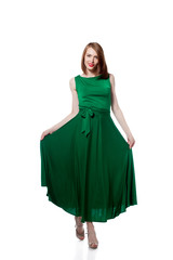 Happy young woman posing in bright green dress