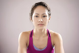 Asian chinese female athlete feeling demotivated and staring int poster