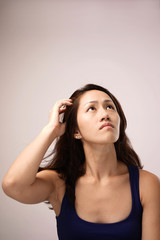 Asian chinese lady feeling puzzled