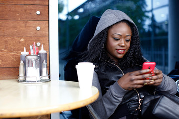 Smiling Woman Busy Text Messaging on Mobile Phone