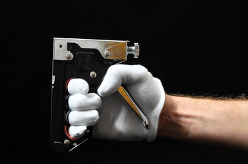 Stapler Pliers and a Hand