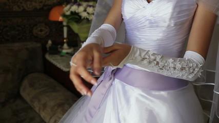 bride dress glove on his hand