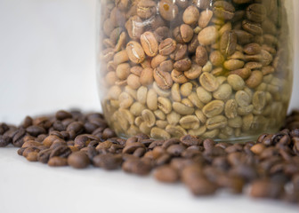 coffee beans in a bottle isolated on a white background