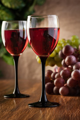 Glasses of red wine and bottle