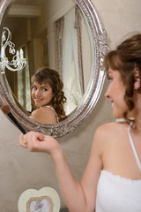Young attractive girl in the mirror