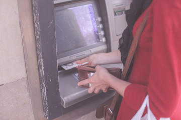 Young woman at ATM