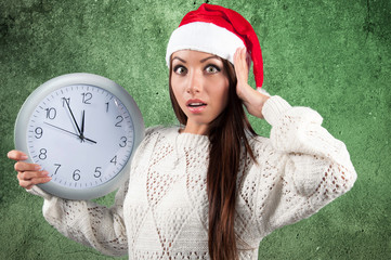 woman with clock and Christmas hat
