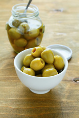 green olives in a white bowl