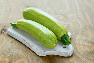 two zucchini on a cutting board