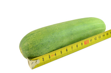 Big cucumber and measuring tape on white background ,Penis size